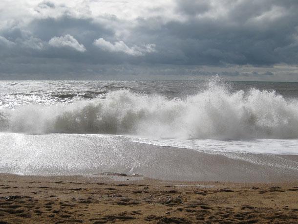 waves crashing onto shingle beach