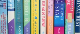 Self-help books on bookshelf
