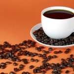 cup of black coffee and coffee beans