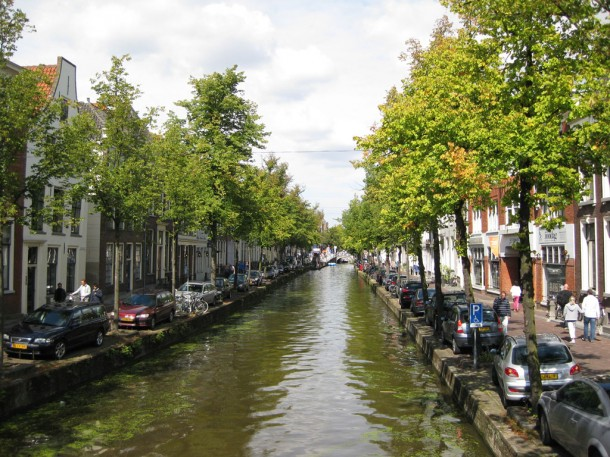 canal and tree-lined street in Delft