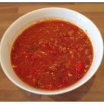 a bowl of spicy chorizo, bean and tomato soup