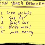 five handwritten new year's resolutions on paper
