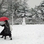 Red umbrella couple in Dulwich Park
