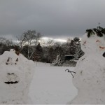 Two snow people in Dulwich Park