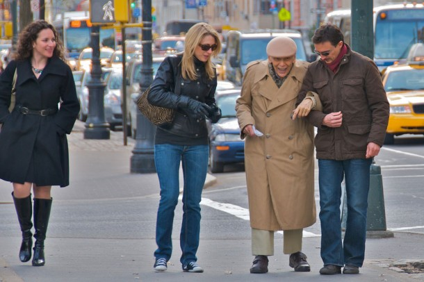kind strangers helping an old man across the street