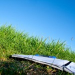 Notebook on grass to illustrate writing to heal, the healing power of writing