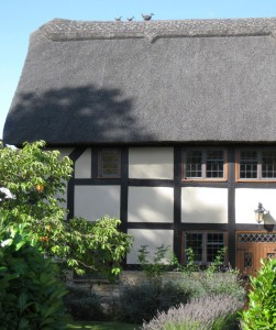 A typical Cotswold thatched roof cottage