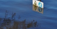 Signs submerged by flood water