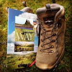 St Cuthbert's Way guide book and walking boots