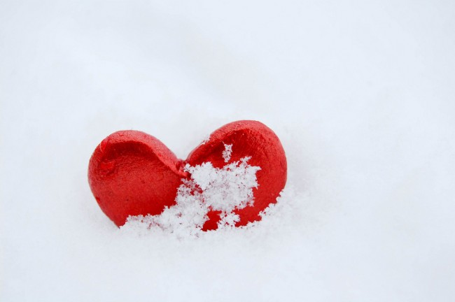 Red heart on snow to represent how the menopause almost destroyed my relationship.