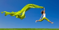 Woman jumping for joy to illustrate how Rolfing changed my life