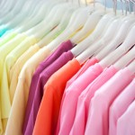 A rack of T-shirts organised by colour